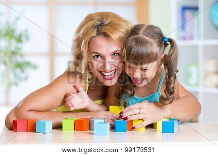 Kid and parent playing in the room