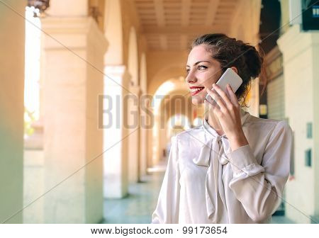 Young businesswoman doing a phone call