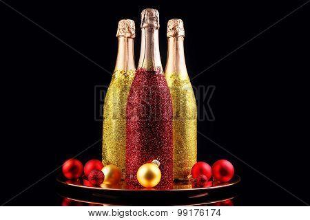 Decorative champagne bottles on dark background