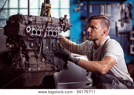 Car Technician Maintaining Automotive Engine