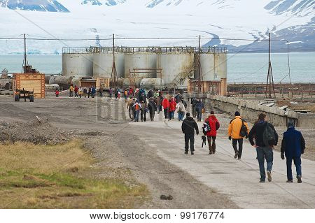 Tourists visit abandoned Russian arctic settlement Pyramiden, Norway.