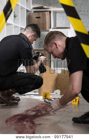 Policemen At The Murder Scene