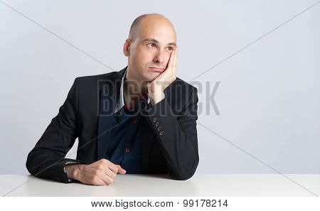 Businessman Thinking At Office Desk