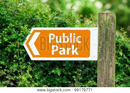Direction Arrow, Sign To Public Park in Orange Color