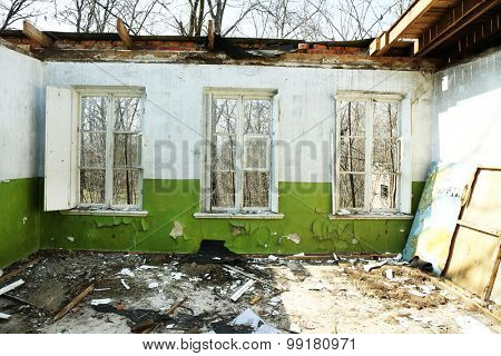 Three windows in abandoned house