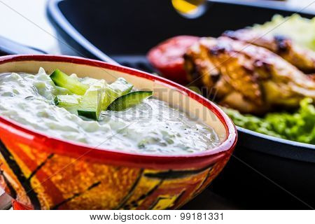 Tzatziki sauce. Tzatziki dressing. Tzatziki dressing with grilled chicken legs
