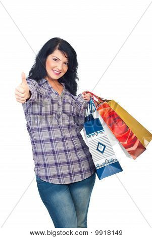 Happy Woman With Shopping Bags Give Thumbs
