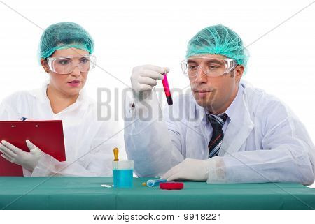 Scientist Team In Laboratory With Blood Tube