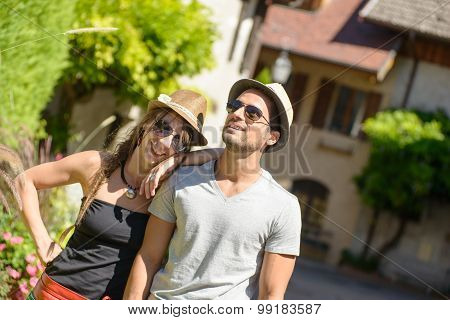 Young Couple With Hats And Sun glasses On Vacation
