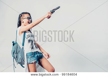 Fashion swag sexy girl holding gun woman having fun  hooligan, rebel.