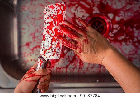 Hand hold bloody knife in a steel shell for halloween