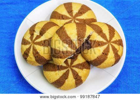Cookies with chocolate on white plate