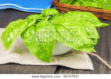 Spinach in bowl on table