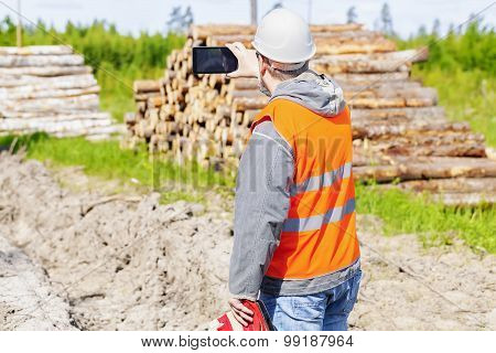 Forest engineer with tablet PC in forest