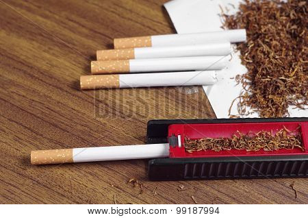 Cigarettes And Rolling Machine