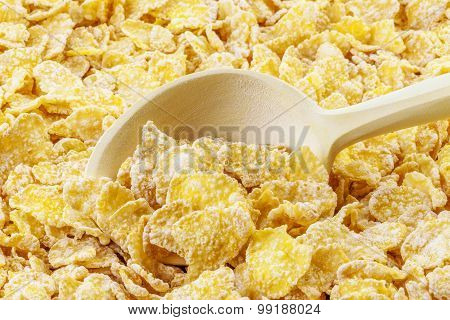 Cornflakes with wooden spoon