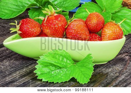 Strawberry in green bowl on the table