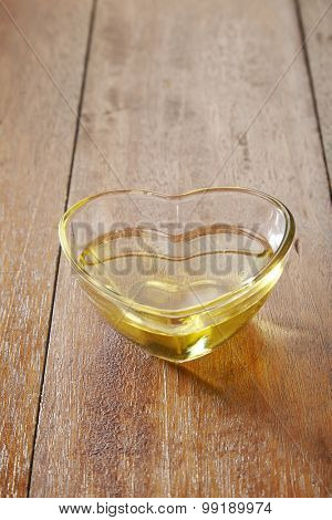 oil in a heart shape container
