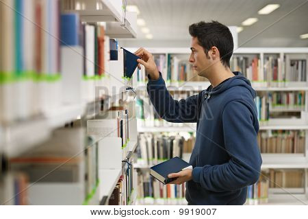 Man Choosing Book In Library
