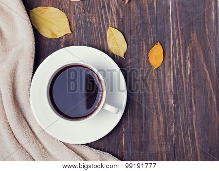 Cup Of Coffee, Blanket And Leaves On The Wooden Background,