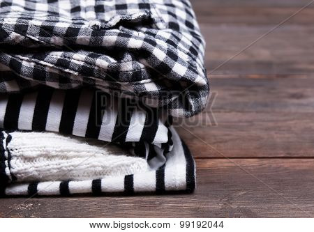 Stack Of Black And White Clothes With Striped And Checkered Patterns