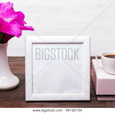 White Empty Frame With Place For Text On The Table