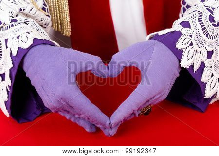 close up of hands of Sinterklaas with purple gloves and ring