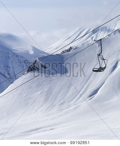 Chair Lift At Ski Resort And Off Piste Slope