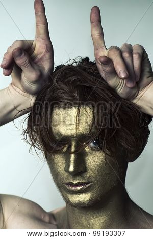 Golden Man With Hands As Antlers