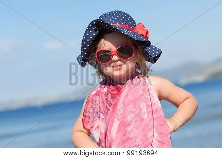 Portrait Of Happy Baby Girl In Hat And Sunglasses