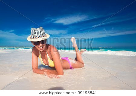 Young woman enjoying sunny day at tropical beach