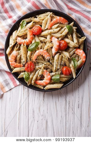 Pasta With Shrimp, Tomato And Pesto Sauce. Vertical Top View