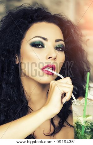 Sexy Woman Drinking Mojitoserious