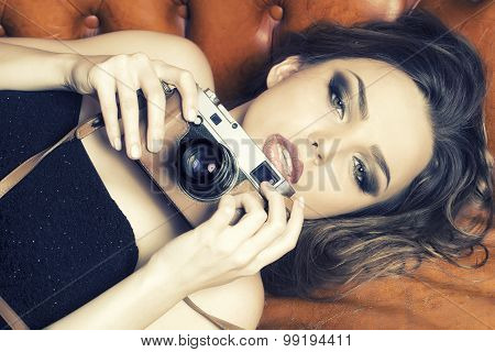 Stylish Woman With Camera