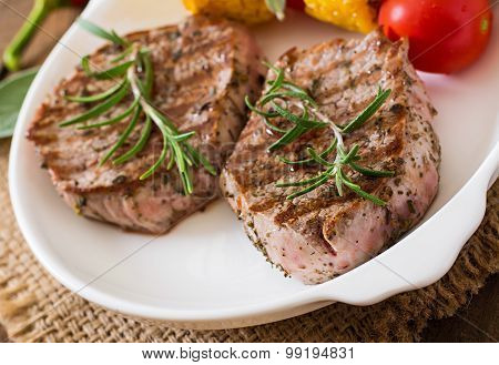 Tender and juicy veal steak medium rare with vegetables
