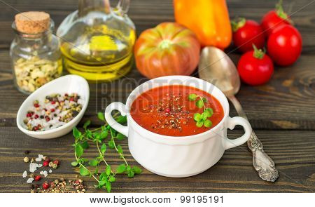 Homemade thick soup made of tomatoes and roasted bell peppers. Selective focus