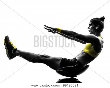 one caucasian woman exercising  crunches fitness in studio silhouette isolated on white background