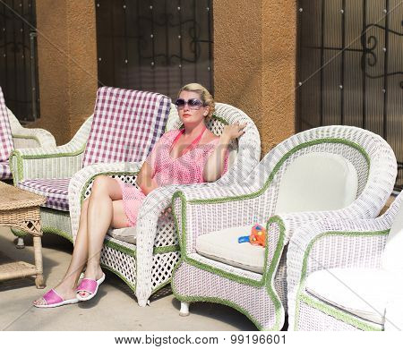 The Woman In The Pink Has A Rest In A Chair