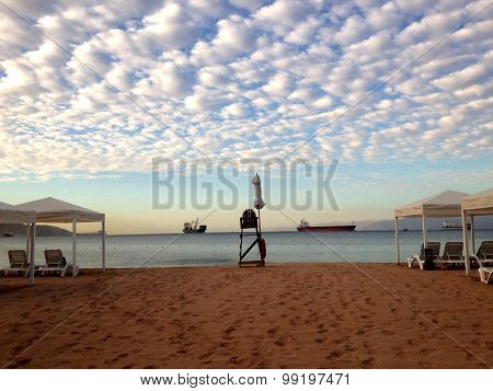 Beach view on the ships in the Sea port