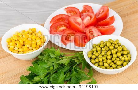 Tomatoes, Green Peas, Sweet Corn And Parsley On Board