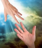 pic of hand god  - A hand is reaching out or grabbing for help from another hand in the sky - JPG