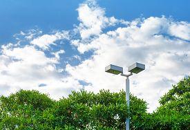 pic of light-pole  - light pole at park in nice blue sky - JPG