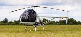foto of helicopters  - the white helicopter on the grass airfield - JPG