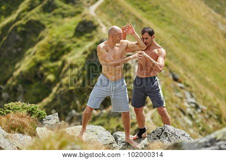 Kickbox Fighters Sparring In The Mountains