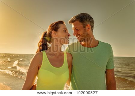 walking couple after fitness run