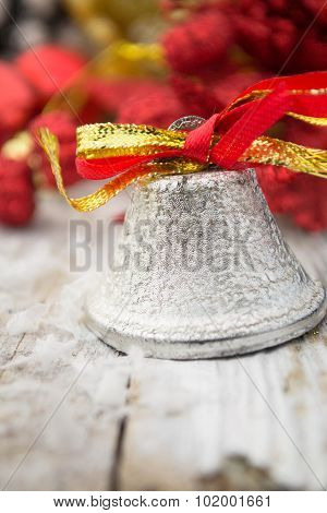 Jingle bell on wooden surface with copy space