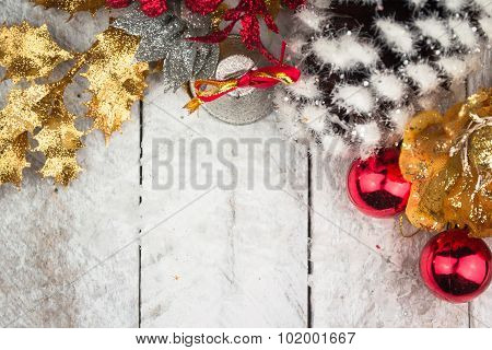 Christmas decorations in red and gold tone on wooden background