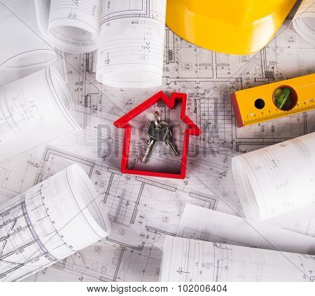 Hard hat with blueprints and rulers