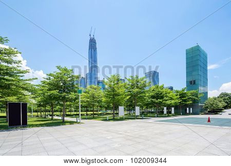 skyscrapers located in the square of Shenzhen with tress around