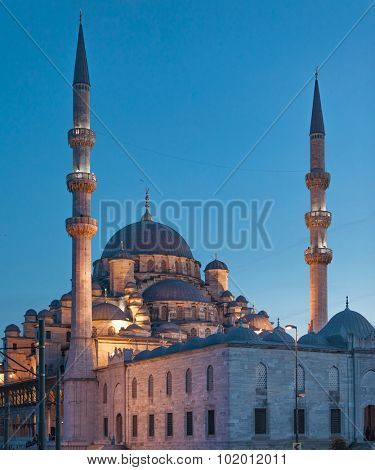 The New Mosque (Yenicamii) at night in Istanbul Turkey